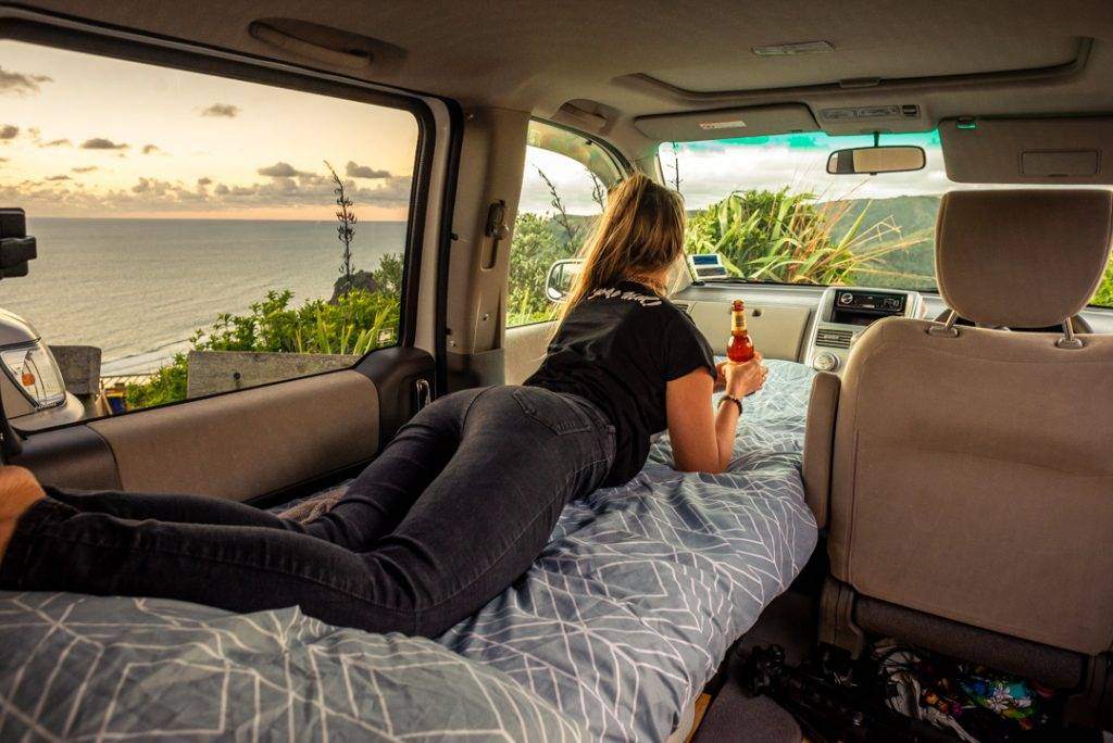 enjoying beer with a view from inside my campervan