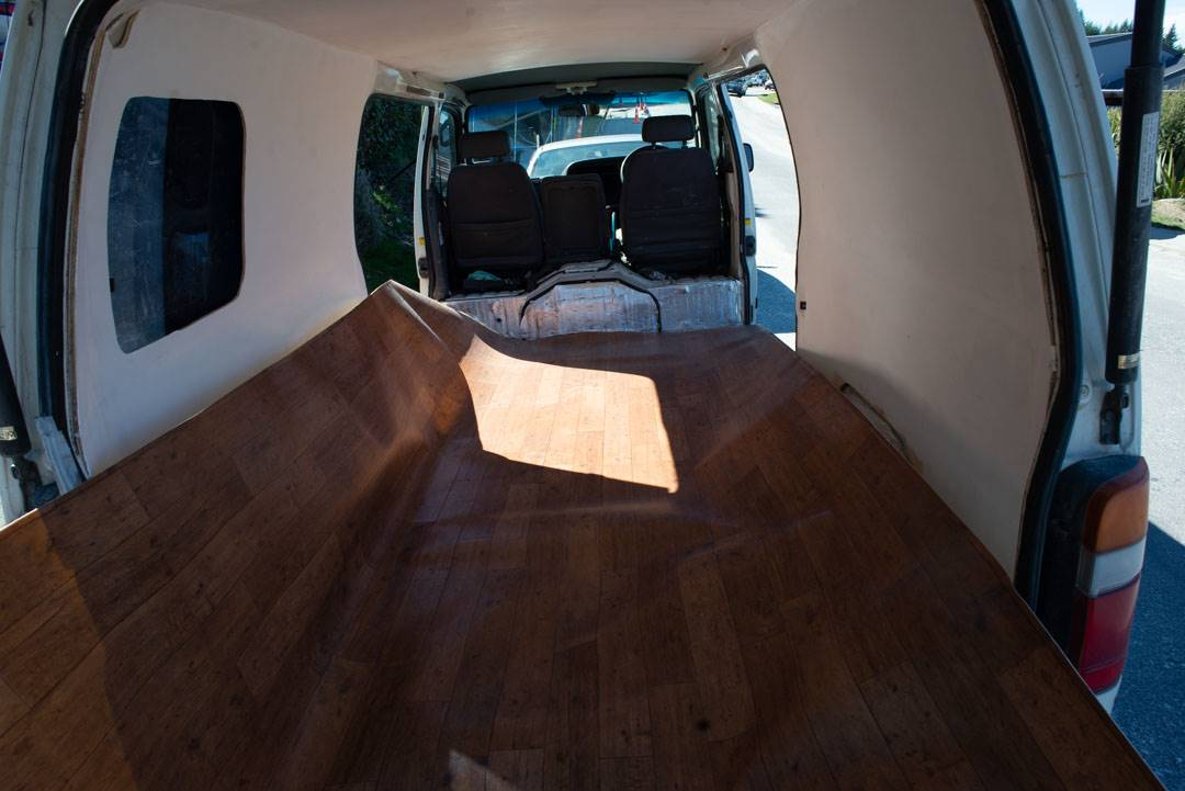 installing the flooring in our campervan conversion