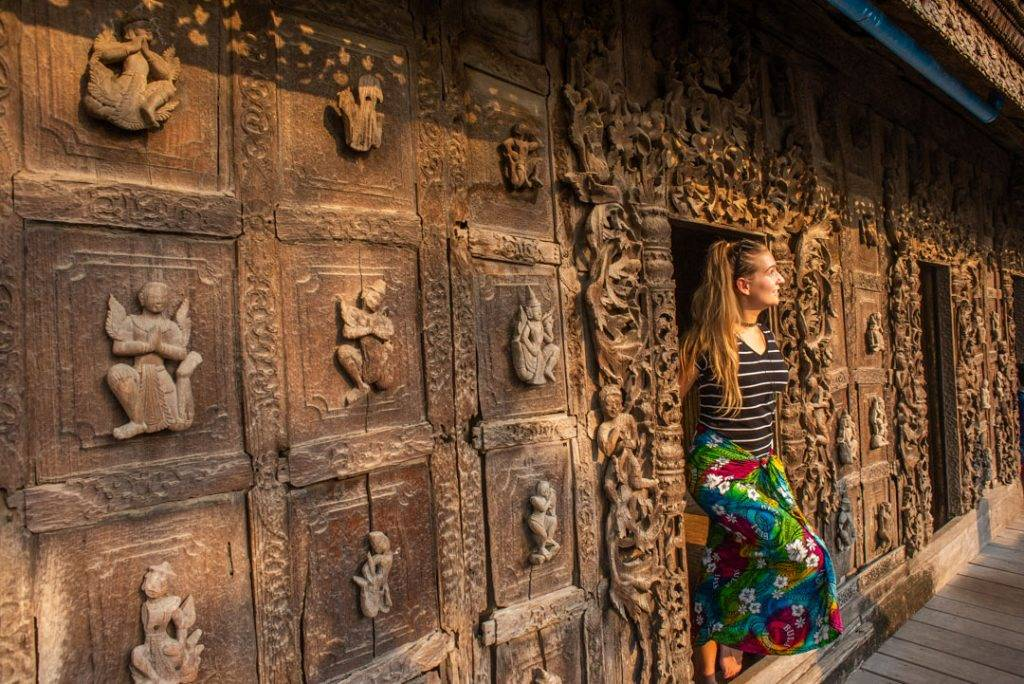 exploring the wooden temple in Mandalay