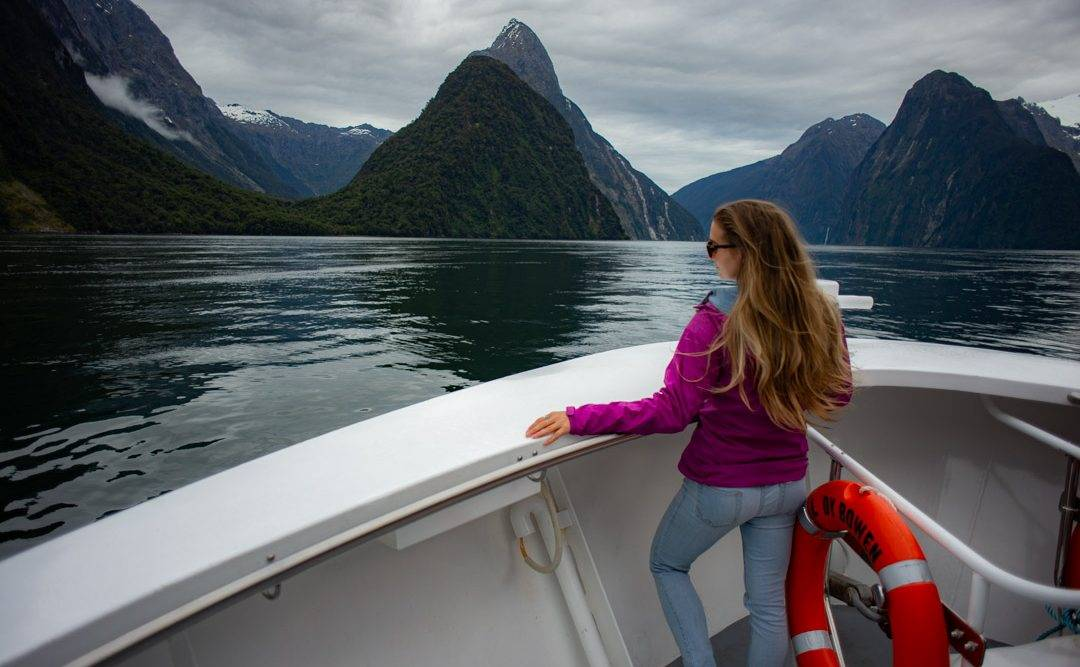 woman standing on a boat in Milford Sound