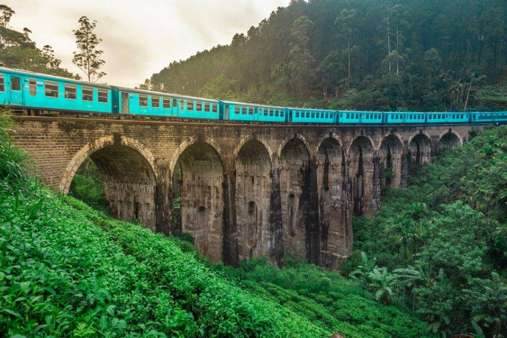 Blue train on Nine Arches Bridge train from kandy to ella