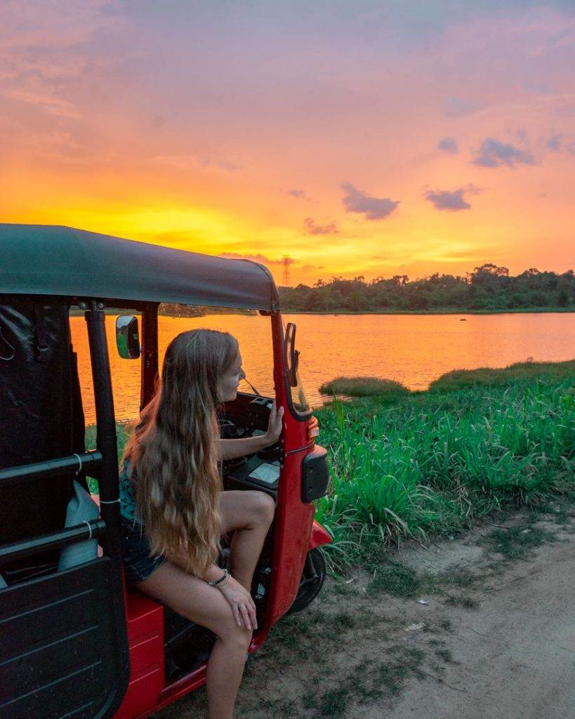 Watching sunsets in Sri Lanka from our tuk tuk