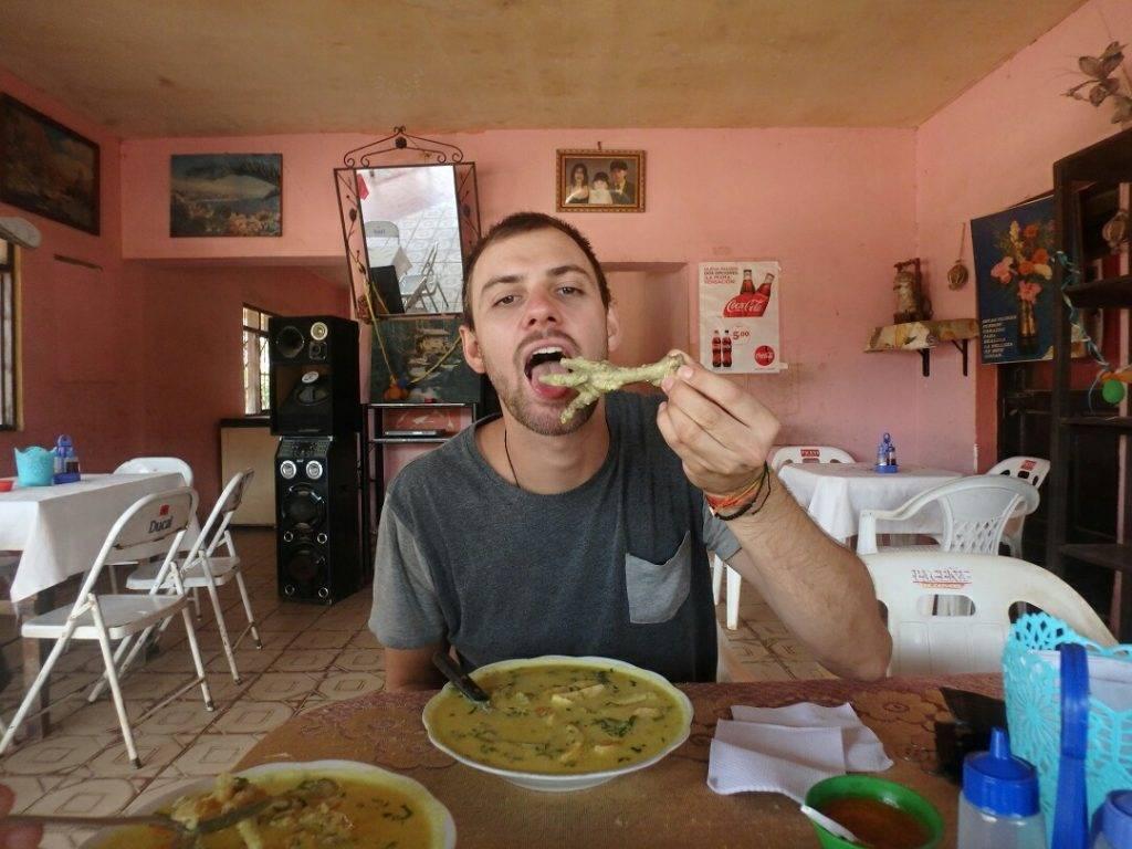 Daniel eats chicken feet soup in Bolivia