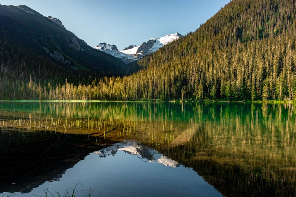 Reflections of the mountains on the first lake on the Joffre Lakes hike near Whistler, BC