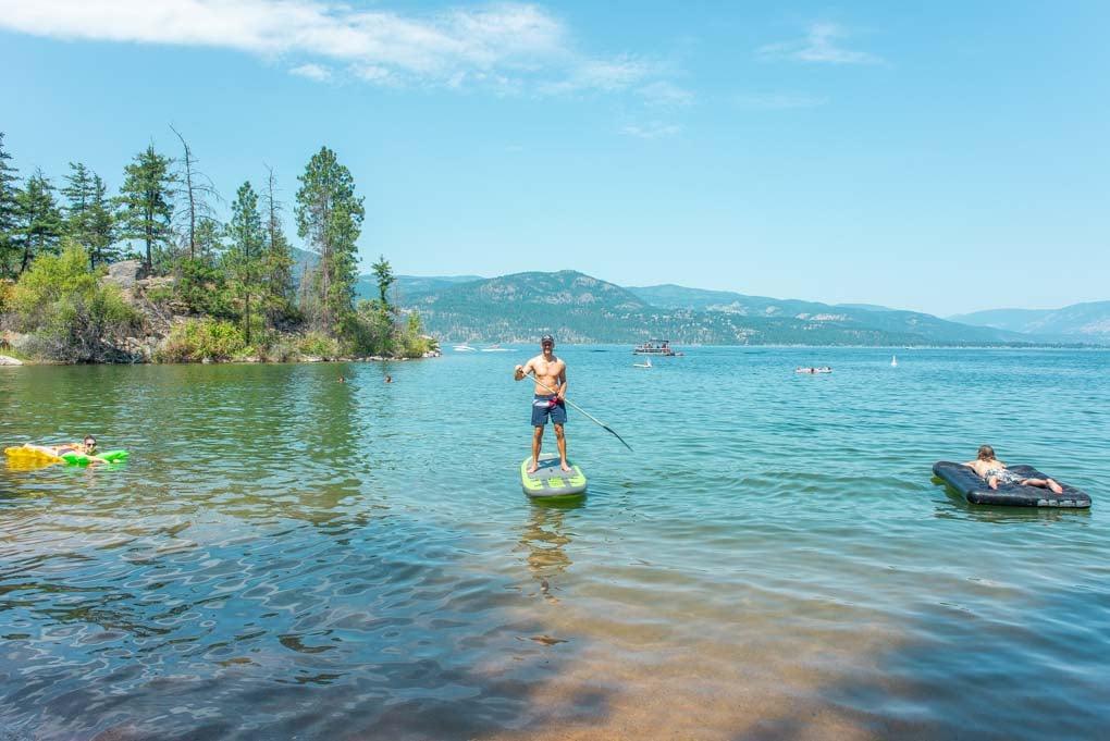 Daniel paddle boarding at Ellison Provincial Park, Vernon