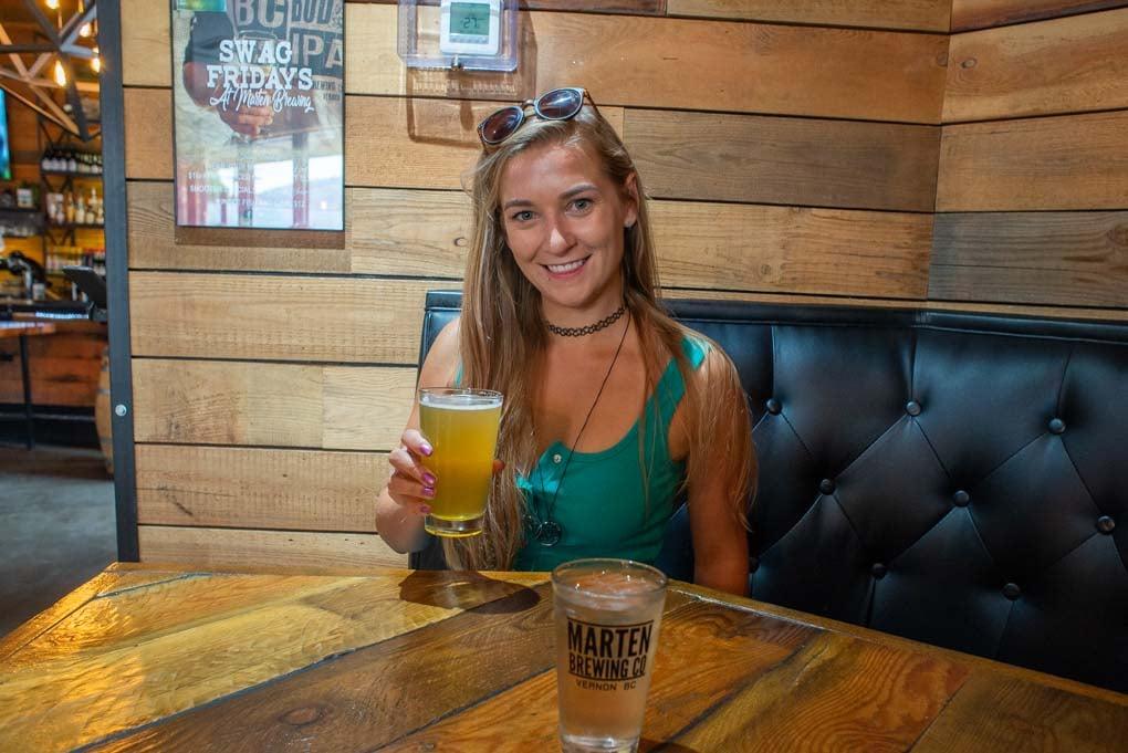Bailey holding a berr at Marten Brew Pub, Vernon