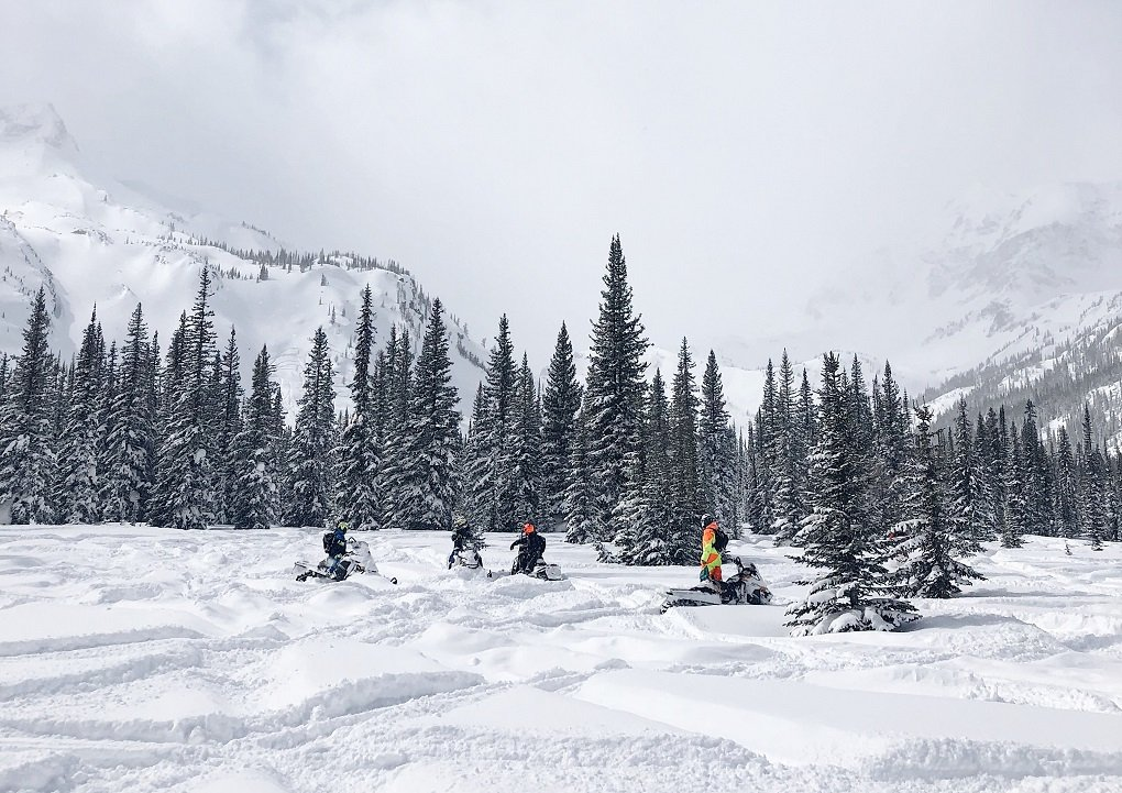 a group of smowmobilers in whistler, canada