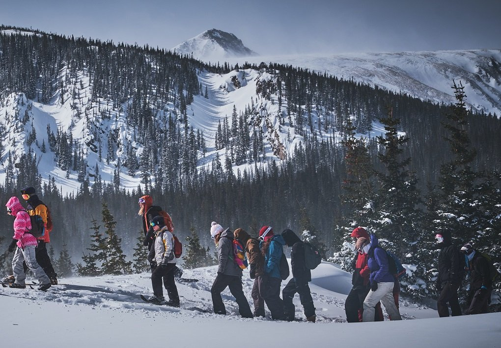 group of people snowshoeing near Whistler, Canada