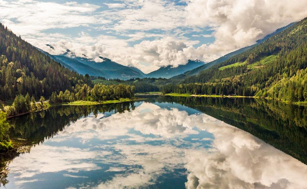 Stunning reflections on a clam morning at Griffin Lake near the town of Revelstoke, BC showcasing the beauty of the area