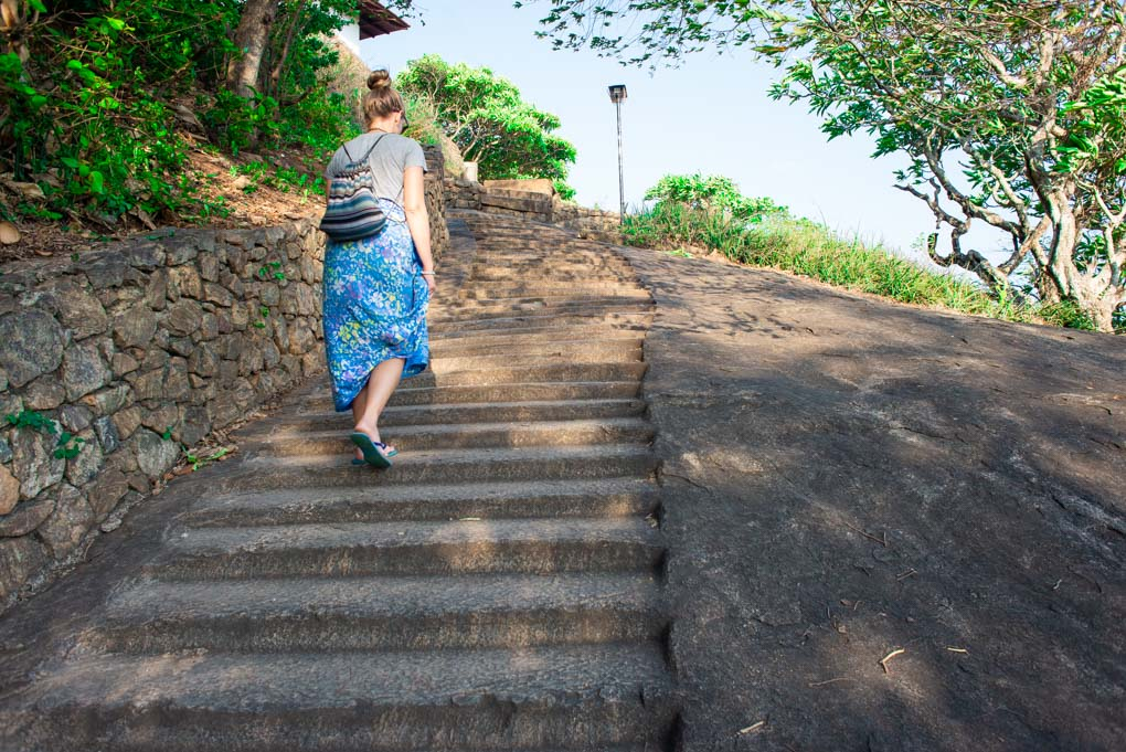 walking up the stairs to the Dambulla Cave Temples