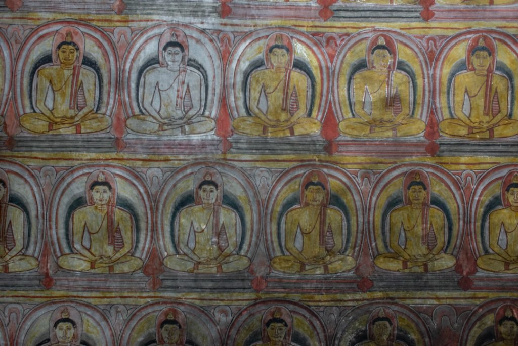 The paintings on the walls of the Dambulla Cave Temple