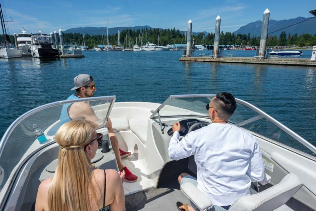 A group of friends go boating in Vancouver Harbor