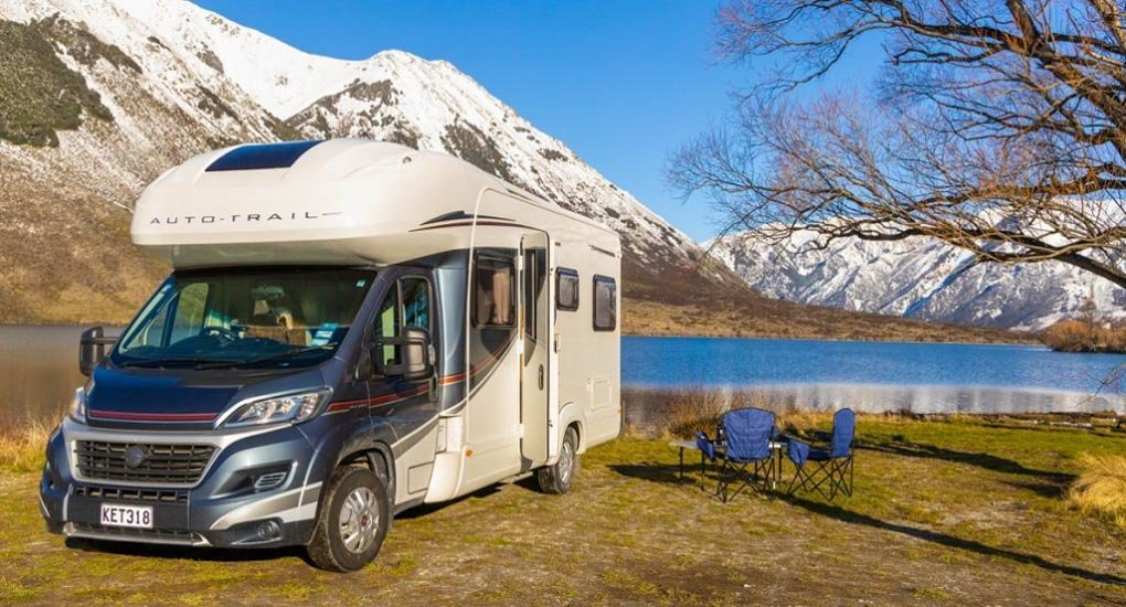 A New Zealand motorhome sits by a lake in New Zealand