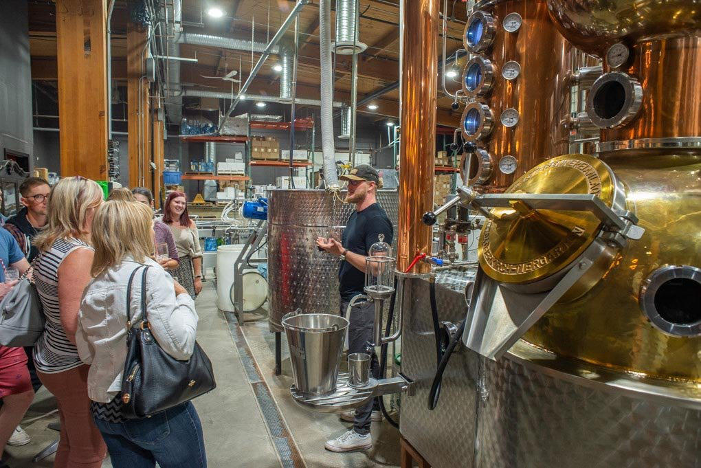 A worker at the Lucky Bastard Distillery in Saskatoon explains to our group the distillery process
