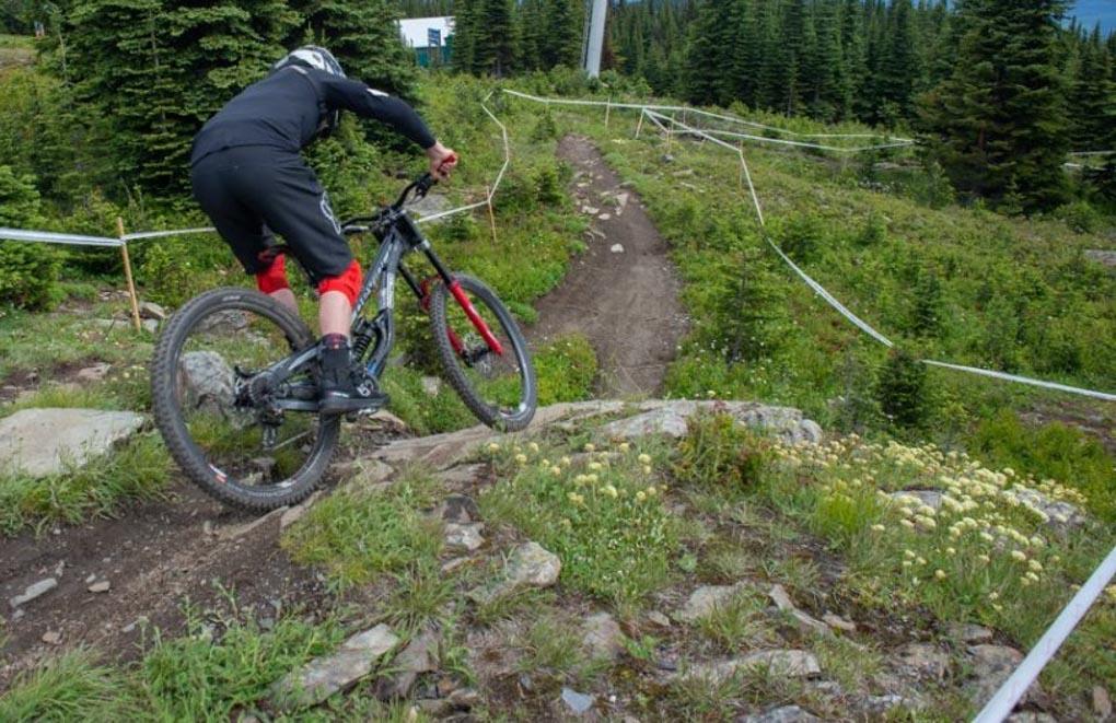 A man rides his mountain bike in a bike park