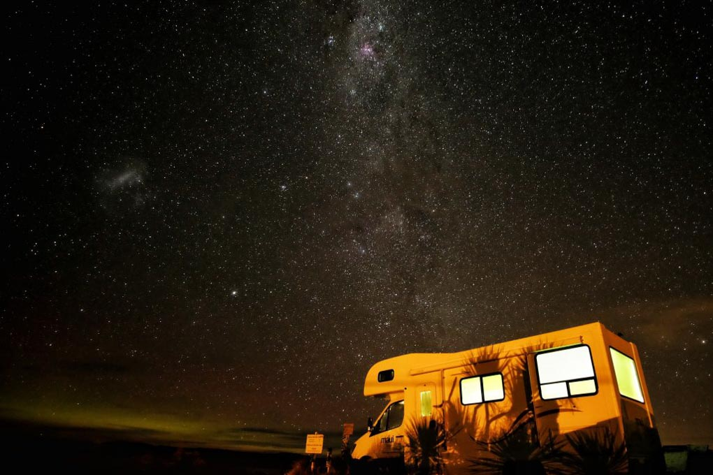 A New Zealand motorhome sits under the milky way