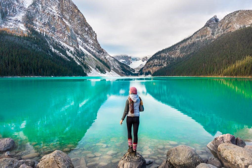 Bailey stands on the edge of Lake Louise, Canada