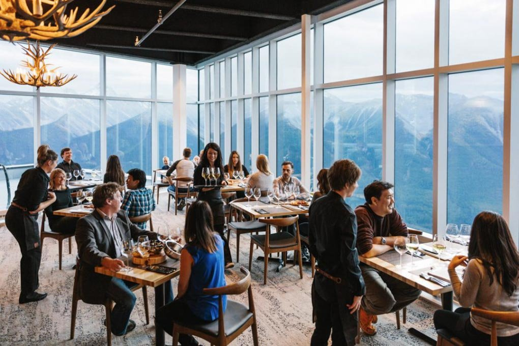 People eat at the Sky Bistro at the top of the Banff Gondola