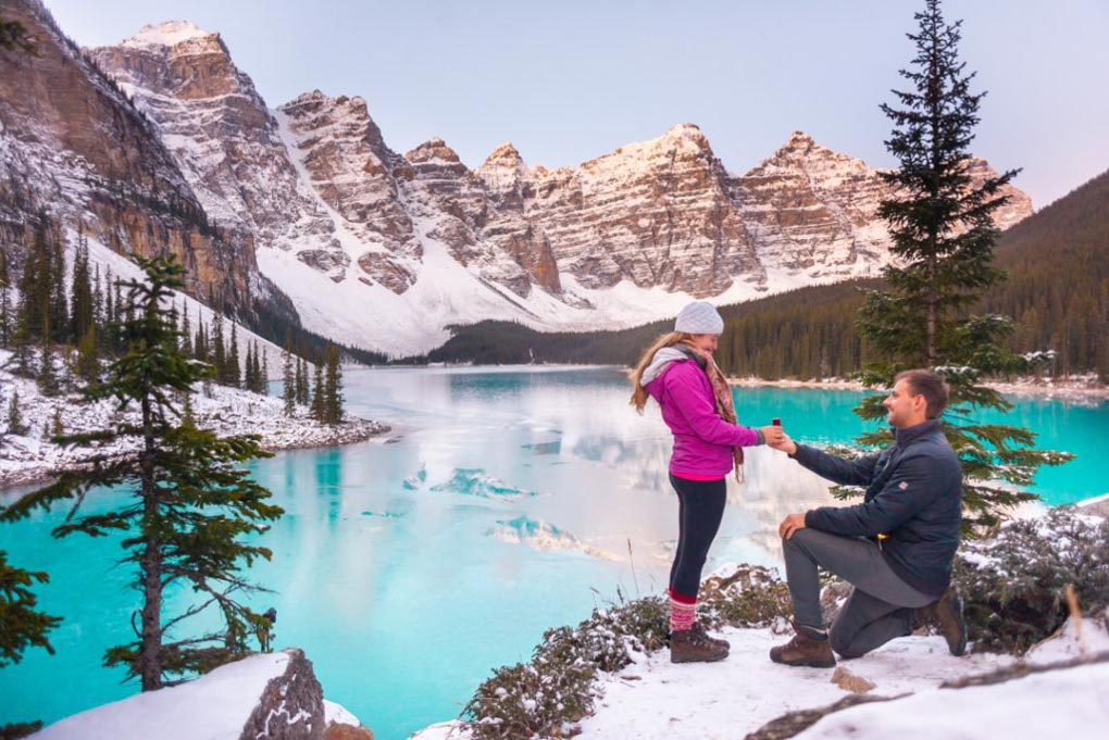 Daniel gets down on one knee and proposes to bailey at Lake Moraine near Banff, Alberta