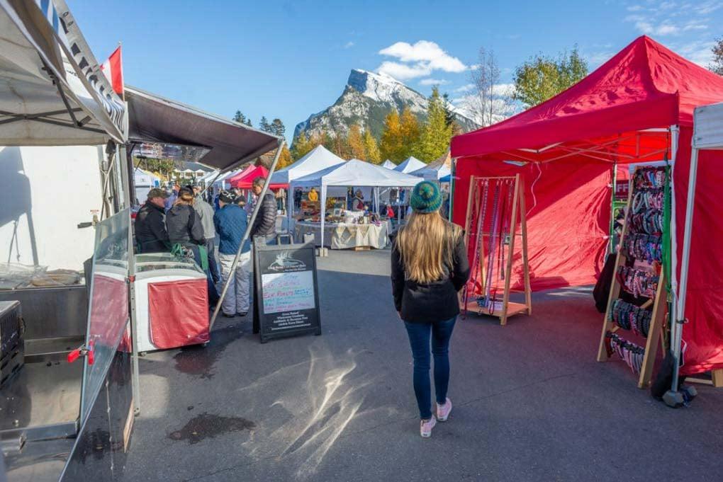 Bailey walks through the Banff Farmers Market