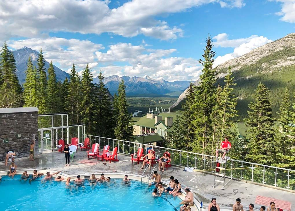 The Banff Upper Hot Springs on a sunny day with the mountains in the background