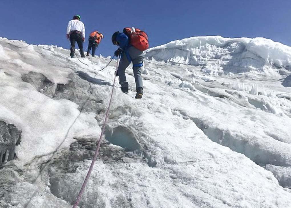 Climbers hike to Nevado del Tolima Summit near Salento, Colombia