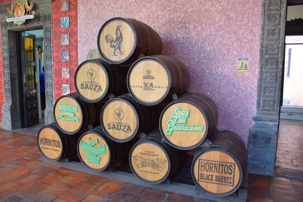 barrels of tequila on a distillery tour in the town of Tequila