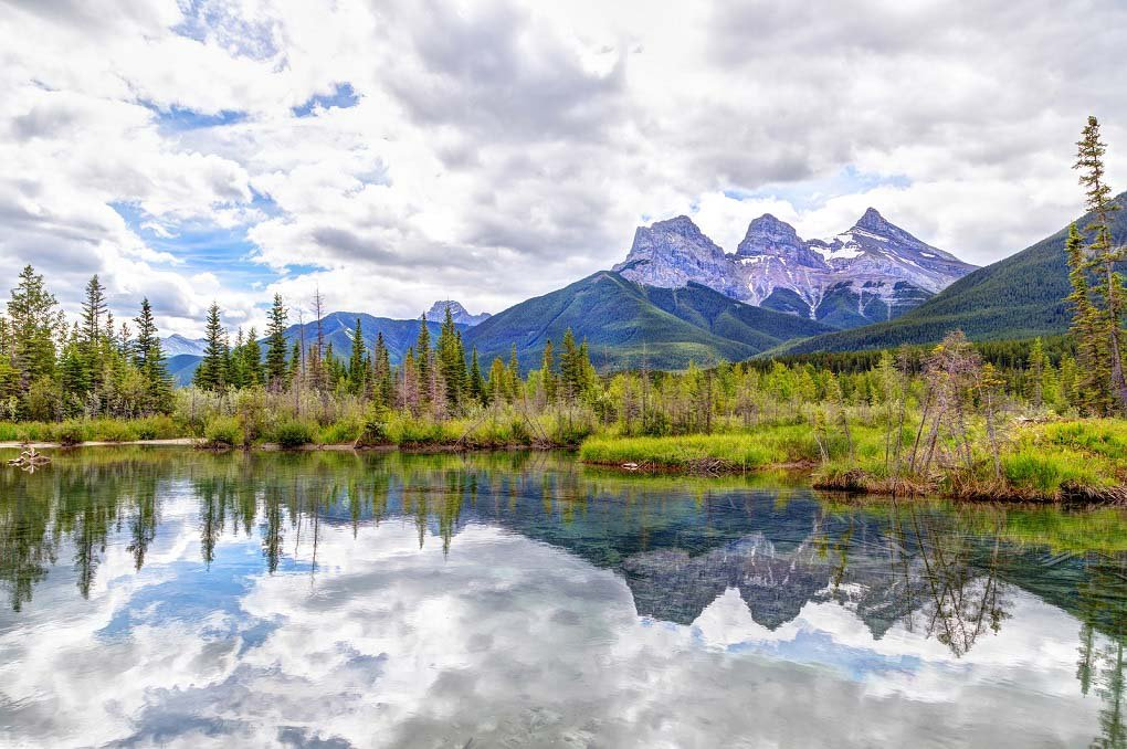 Three Sisters Mountain Peaks In The Canadian Rockies Of Canmore,