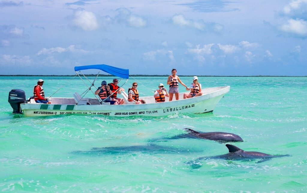 boat of tourists ready to swim with dolphins in Puerto Vallarta