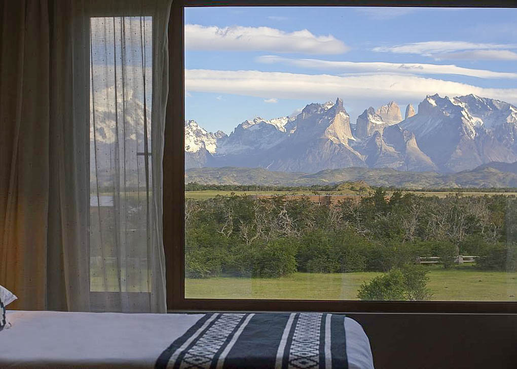 The view of Torres del Paine National Park from a room at Río Serrano Hotel + Spa