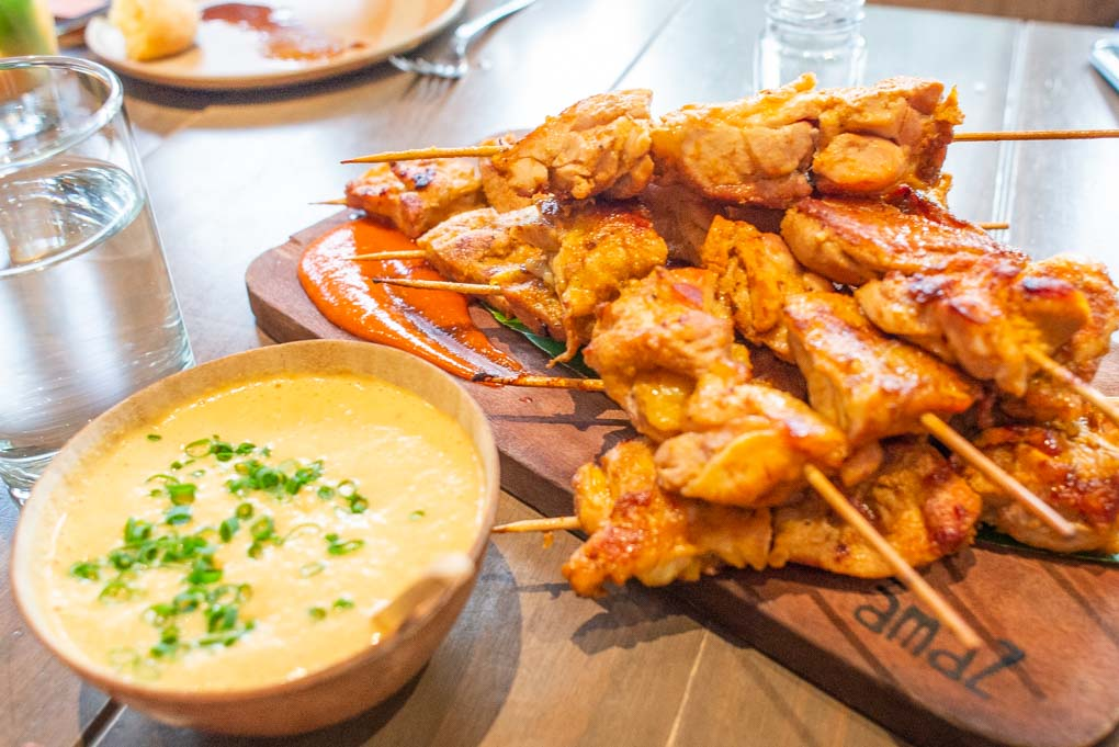 chicken skewers with dipping sauce in peru