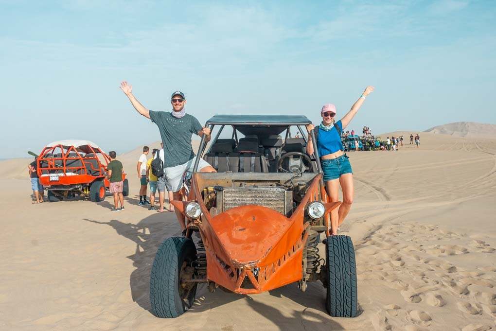 Bailey and I hang out of our dune buggy in Huaccahina