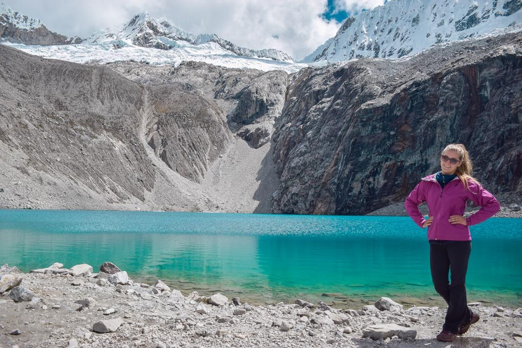 Bailey takes a photo at Laguna 69 in Peru