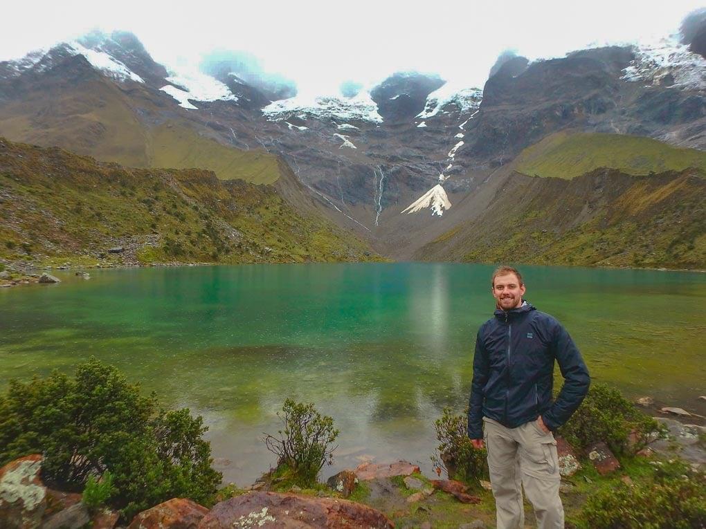 Standing at a lake on the Salkantay Trek