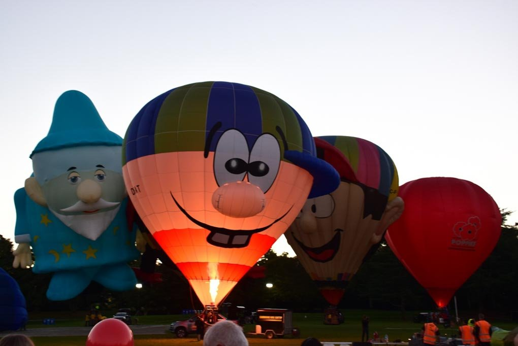 the hamilton hot air balloons getting inflated at the night show