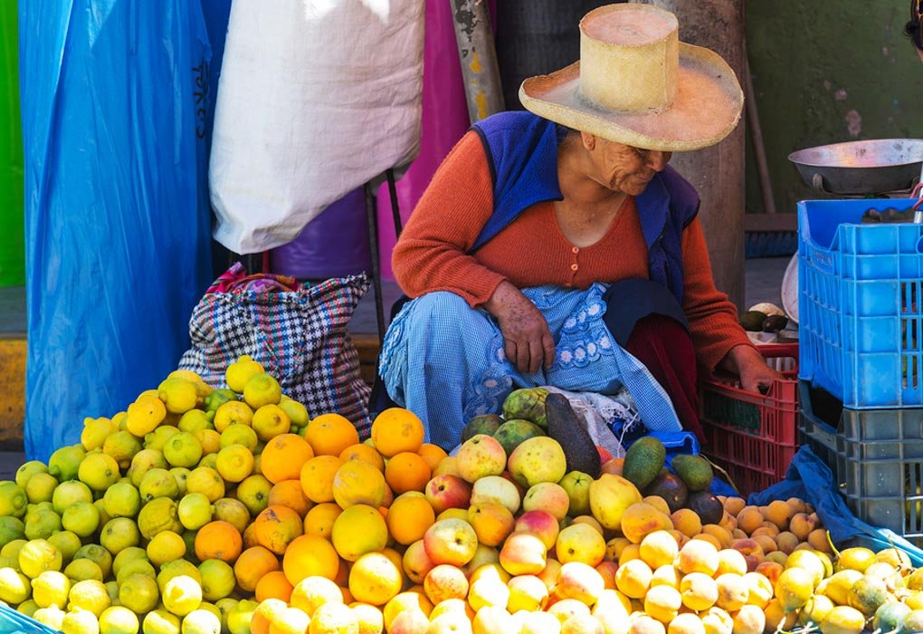 A lady selling fruit at the market in Huaraz, Peru - Photo Credit: Andrushko Galyna on Bigstock