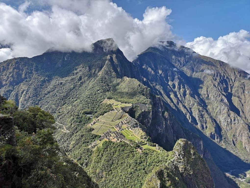A photo of Machu Pichu, Huayna Picchu and Machu Picchu Mountain from Across the valley.