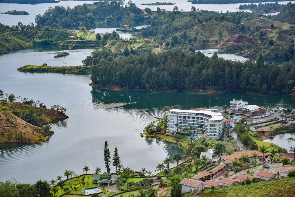 A hotel sits on the edge of the lake in Guatapé.