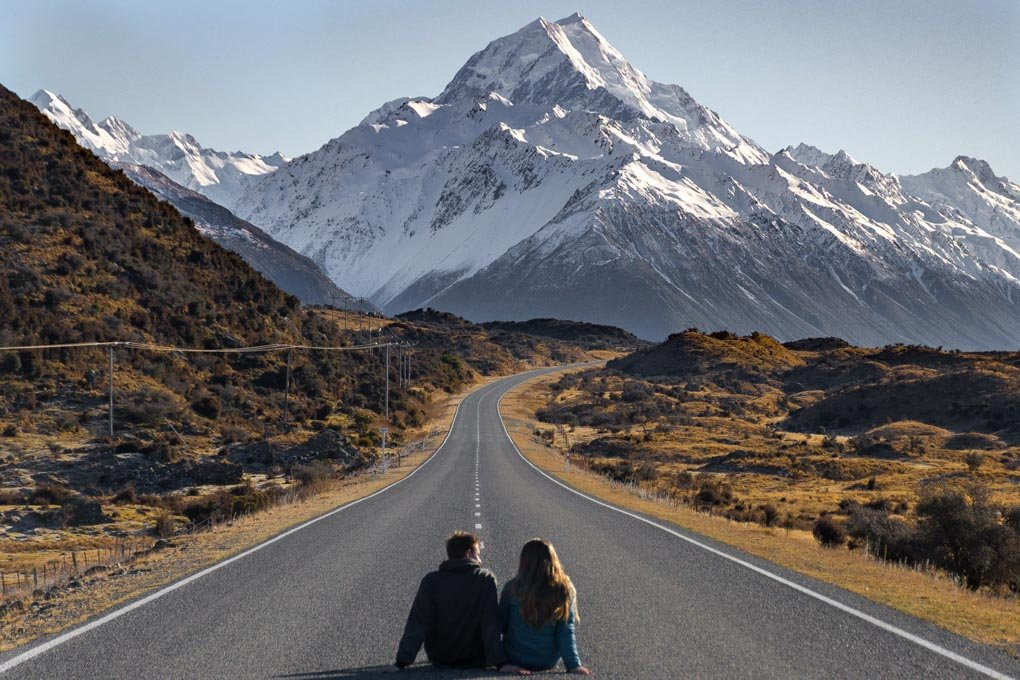 Bailey and I sit on the road to Mount cook