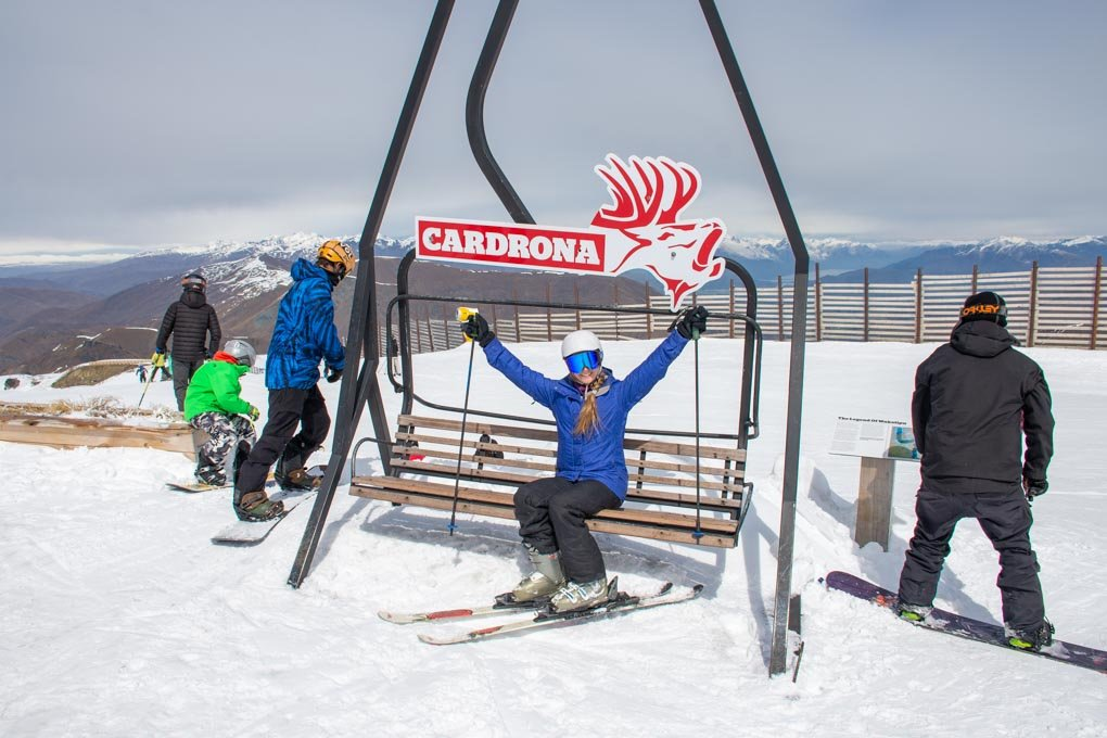 Bailey takes a photo with the Cardron Ski Filed sign