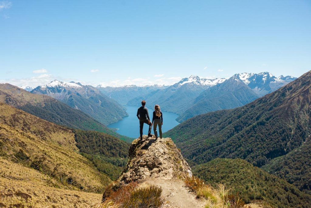 A couple stand on a viewpoint on the Kepler Track, New Zealand