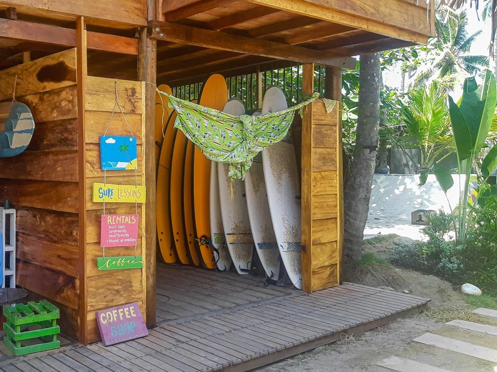 Surf boards at the surf school at Costeño Beach Hostel