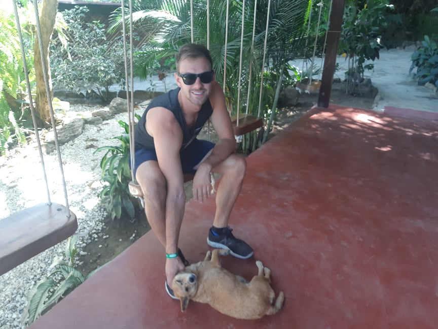 petting a dog at a hostel in minca colombia