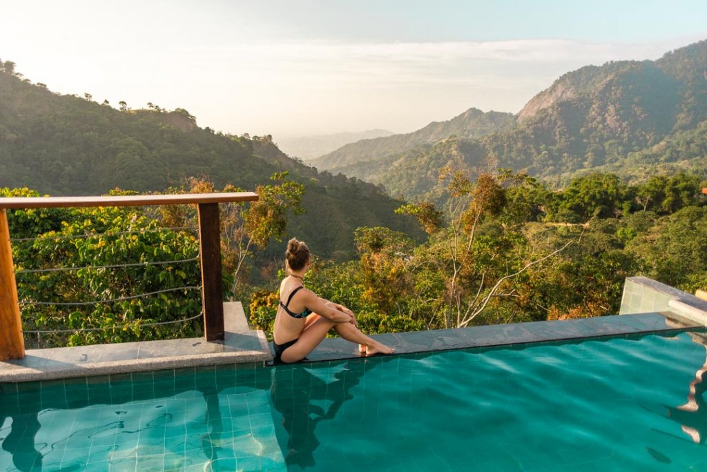 Bailey sits on the edge of the pool at Casas Viejas and overlooks Minca, Colombia