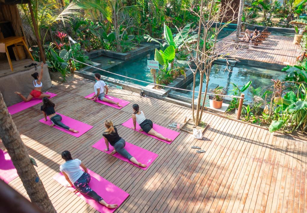 A yoga class by the pool at Costeño Beach Hostel, Colombia