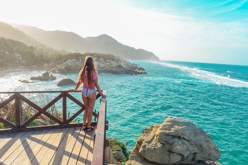 Bailey stands on the viewpoint at Caba San Juan in Tayrona National Park, Colombia