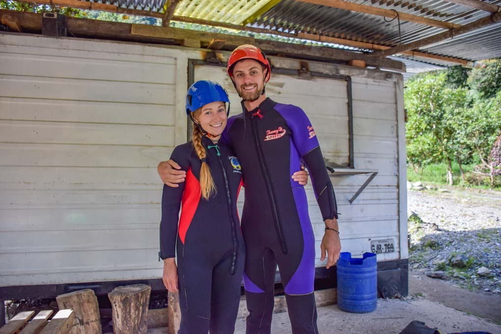 Bailey and Daniel pose for a photo in Banos, Ecuador before going canyoning