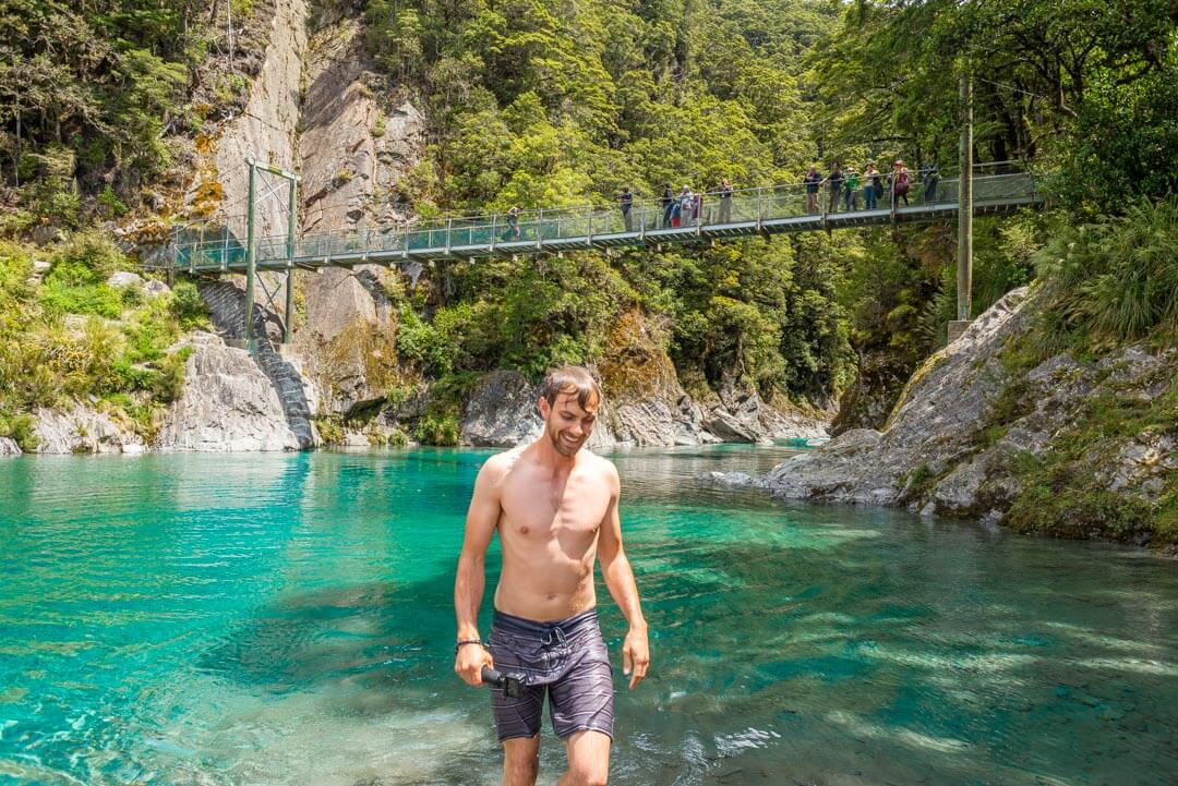 daniel walks our of the blue pools on new zealands west coast