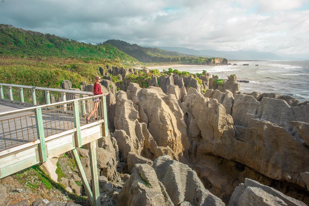 Bailey looks out over the Pancake Rocks in Punakaiki, New Zealand