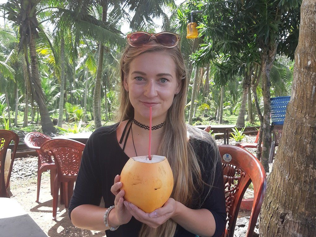 drinking fresh coconut water in Hikkaduwa, Sri Lanka